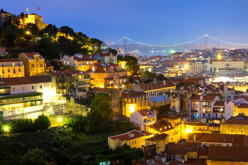 Lisbon in Portugal at night. With the castle and the bridge royalty free stock photos