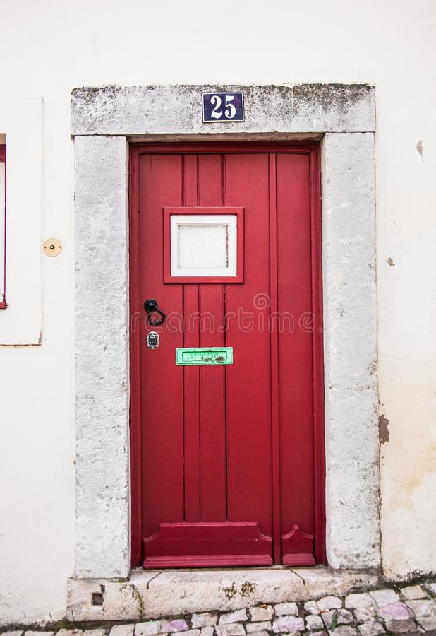 Entrance door in the old house of the historic quarter in Lisbon, Portugal royalty free stock photo