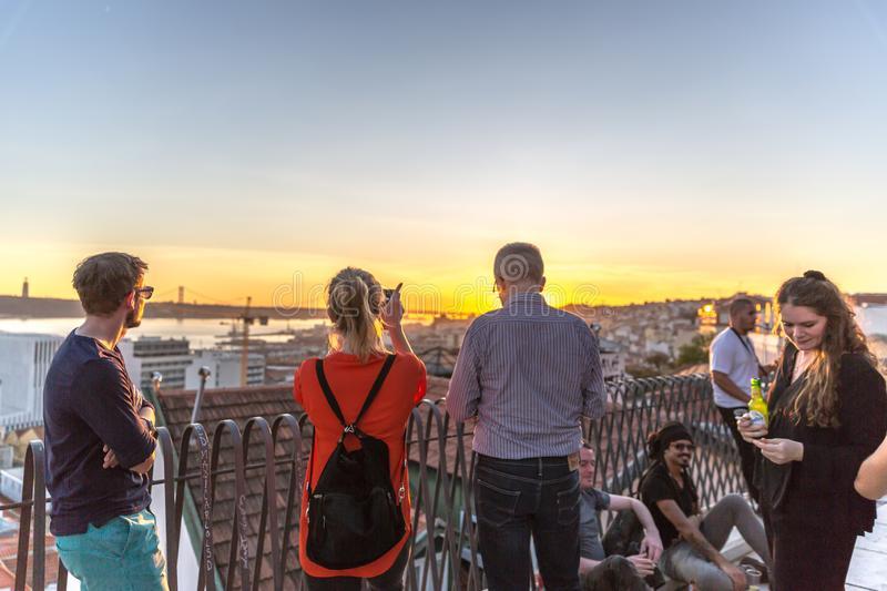 Lisbon, Portugal - Octb 29th 2017 - Tourists and locals enjoying a beautiful sunset in a Chiado Outlook in downtown Lisbon, stock photos
