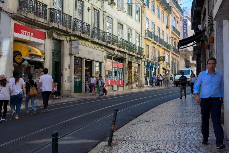 LISBON, PORTUGAL - OCTOBER 01, 2018: Old Lisbon street in a beautiful summer day stock image