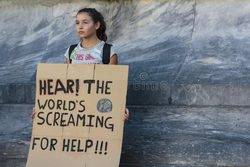 Activist holding a sign in protest for climate change. Lisbon, Portugal- 27 September 2019: Activist holding a sign in protest for climate change stock images