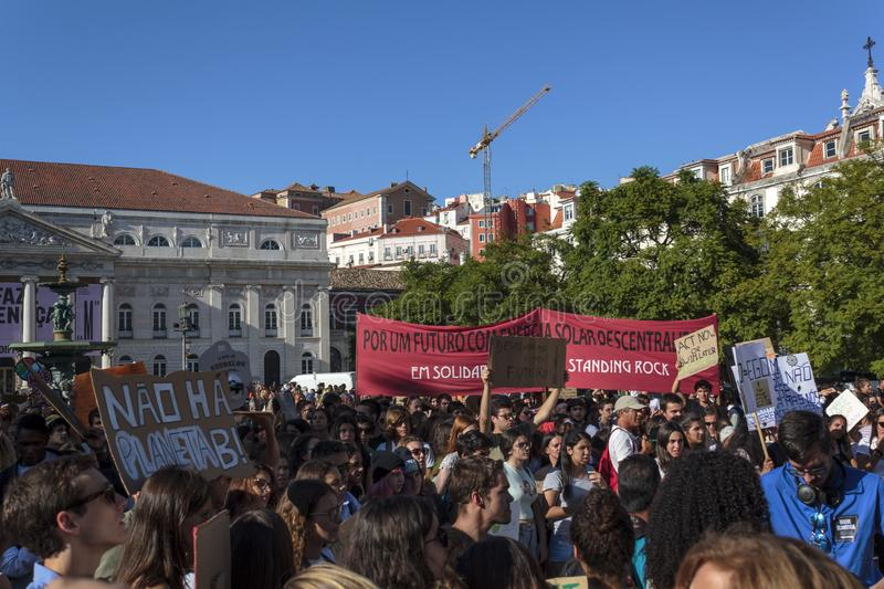 Activists demanding climate change at protest in Lisbon. Lisbon, Portugal- 27 September 2019: Activists demanding climate change at protest in Lisbon royalty free stock photo
