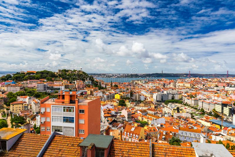 Lisbon, Portugal skyline with Sao Jorge Castle. Panoramic aerial view of Lisbon, Portugal. Panorama view of old town Lisbon and royalty free stock photography