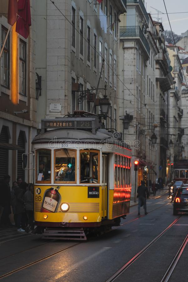 Lisbon, Portugal - 12/26/18: Traditional old yellow Electric tram in downtown lisbon stock photos