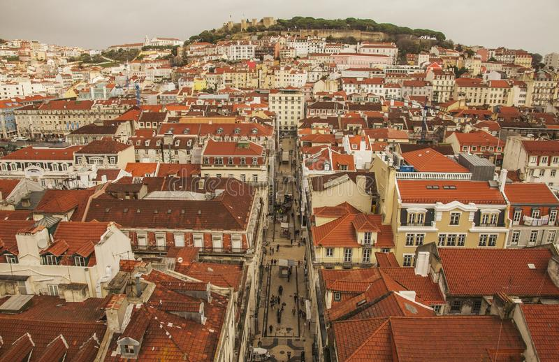Lisbon, Portugal - a view from the Santa Justa Lift on a cloudy day in winter. This image shows a view of Lisbon, Portugal. We can see some streets of the old royalty free stock photography