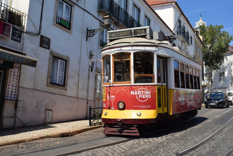 Lisbon's famous Team 28 in Alfama. Portugal 2019. The famous tram 28 in Lisbon's old city, Alfama. The number 28 Lisbon tram connects Martim Moniz royalty free stock images