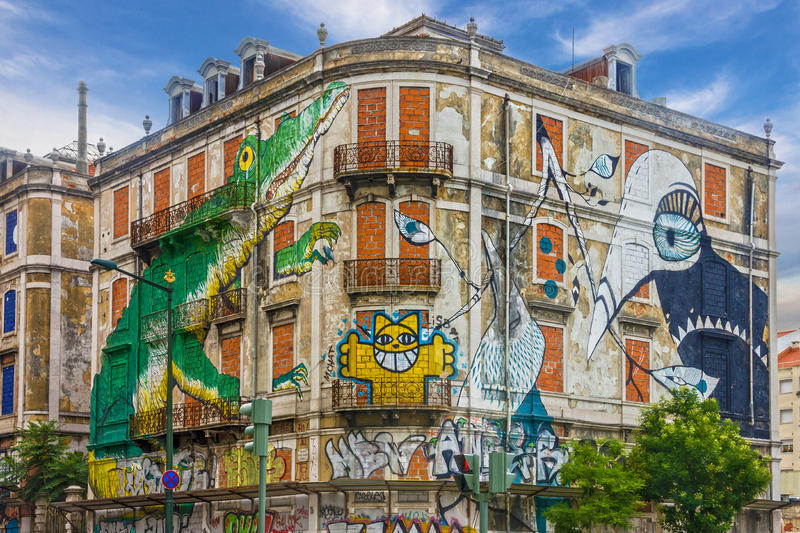Lisbon street art. graffiti green crocodile. Painting house, Ave royalty free stock images