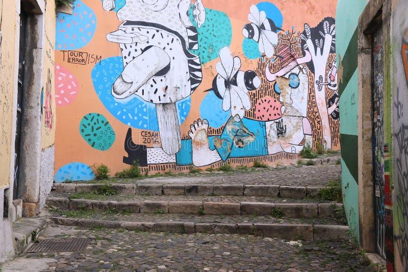 Lisbon street art. LISBON, PORTUGAL - JUNE 4, 2018: Old town public street Beco do Maldonado in Lisbon featuring urban art by Cesah made for Paratissima festival royalty free stock images