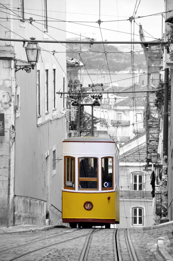 Lisbon tram. In portugal - black and white photo with yellow tram royalty free stock photo
