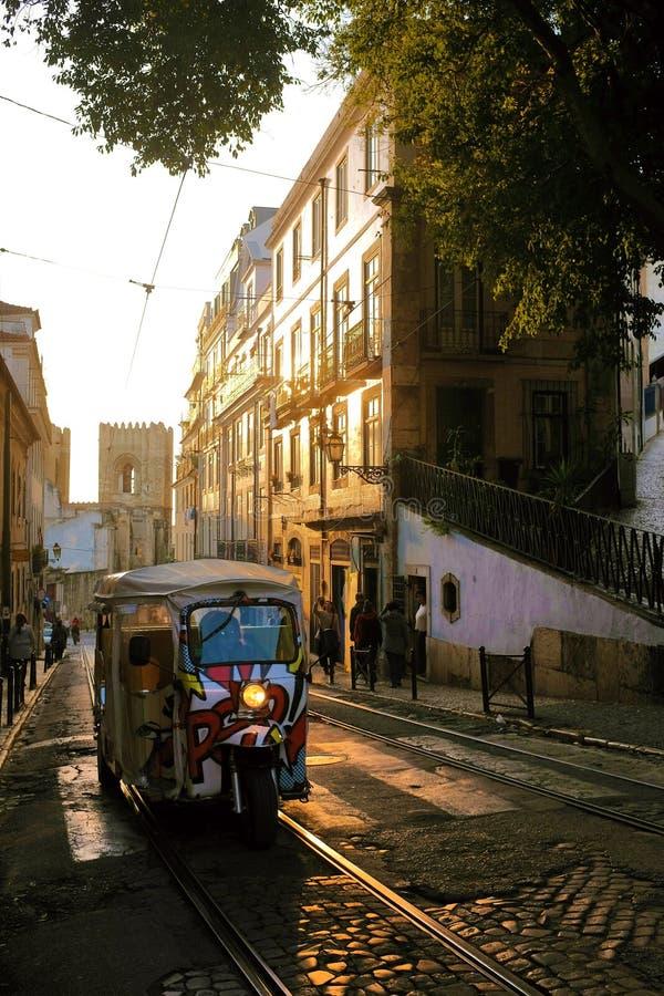 Lisbon Tuk-Tuk. LISBON, November 22 - 2016. A Tuk-tuk goes up on a tour in an old street of Lisbon, Portugal stock image