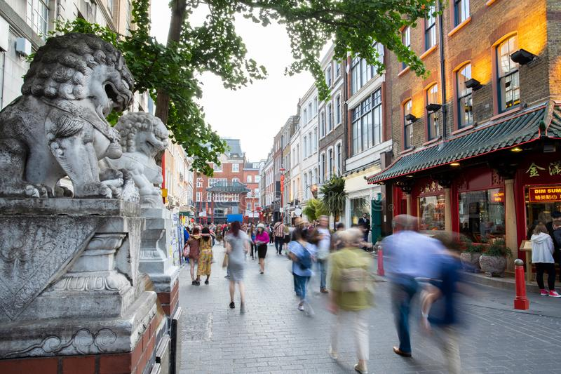 Lisle Street In London Chinatown UK With Motion Blurred Tourists. Lisle Street In London Chinatown UK Busy With Motion Blurred Tourists stock photos