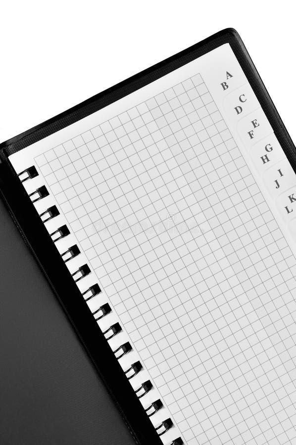 Listín de teléfonos espiral comprobado, modelo del fondo del cuaderno de la dirección, libreta abierta ajustada a cuadros vertica fotografía de archivo