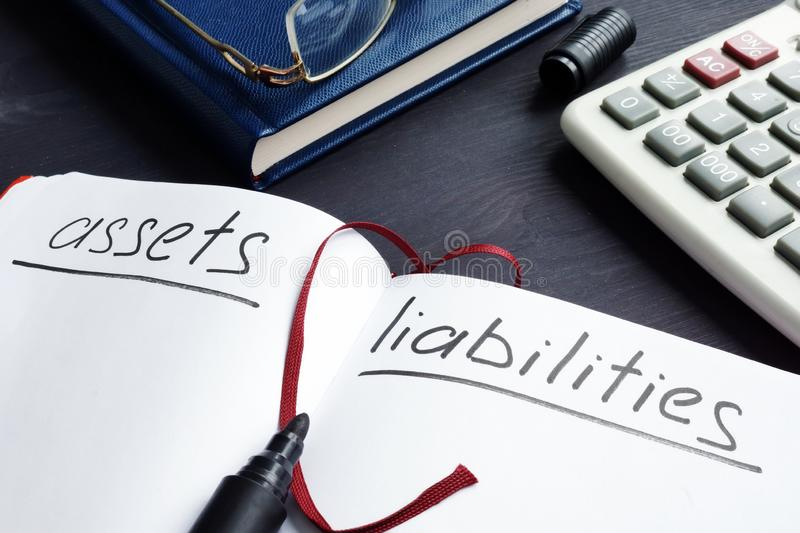 List of assets vs liabilities in the note. List of assets vs liabilities in the note pad stock image