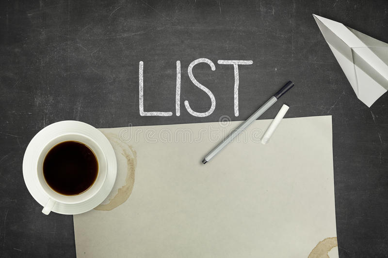 List concept on black blackboard with empty paper stock image