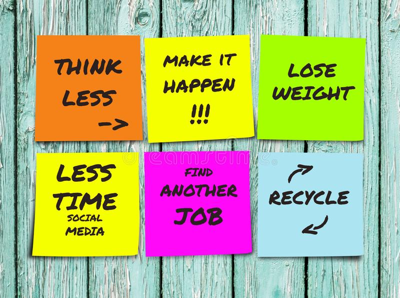 List of handwritten 2019 New Year resolutions and goals in sticky notes in commitment determination and positive thinking concept stock image
