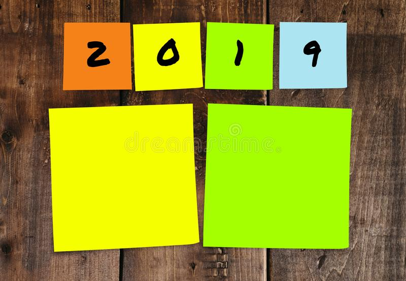 List of handwritten 2019 New Year resolutions and goals in sticky notes in commitment determination and positive thinking concept stock photography