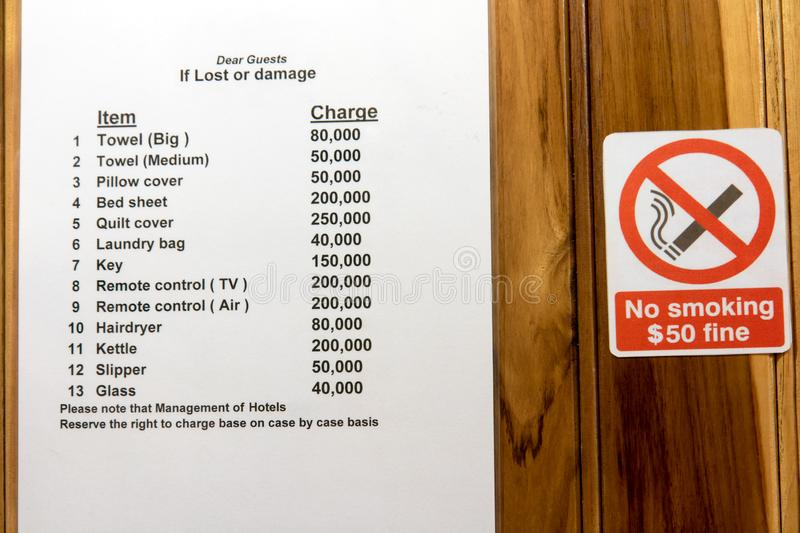 List of items in a hotel room with a quoted price. In case of damage or loss, warning for guests royalty free stock photography