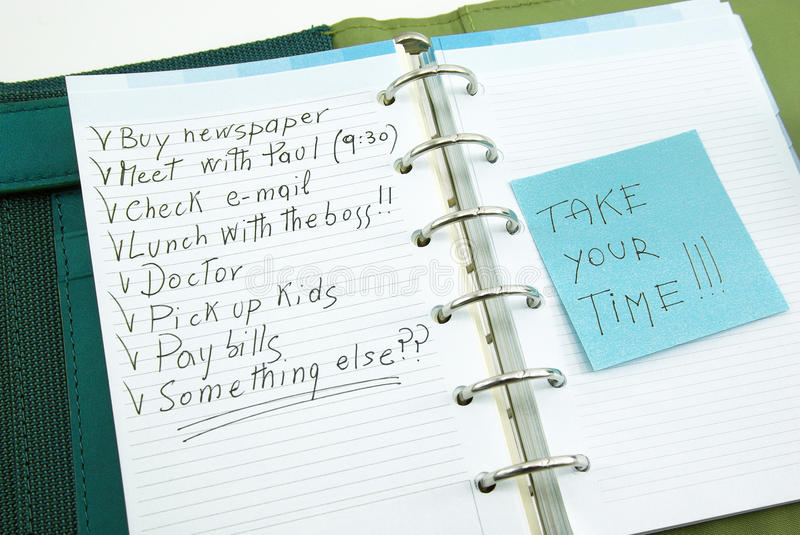 A list of things to do with post it. A list of things to do on notepad with post it, take your time royalty free stock photo