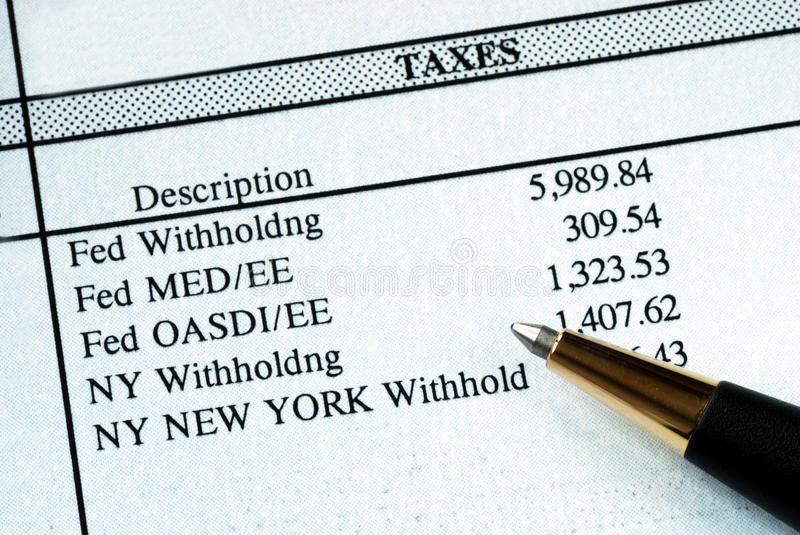A list of withholding taxes. From the pay stuff royalty free stock photography