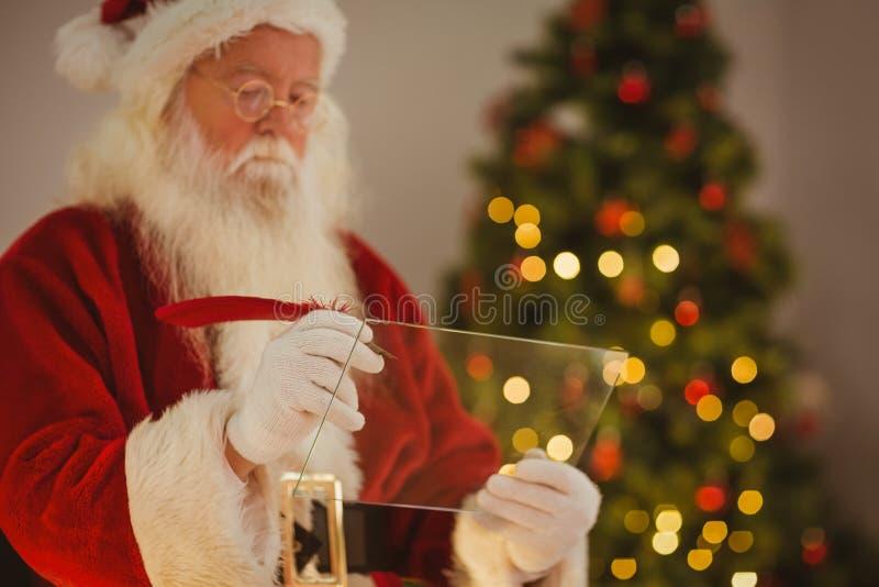 Lista da escrita do Natal do pai no vidro imagens de stock royalty free