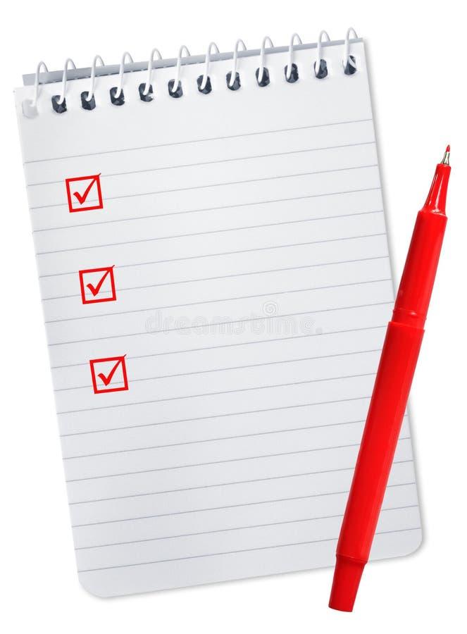 Lista de comprobación en el cuaderno espiral fotos de archivo libres de regalías