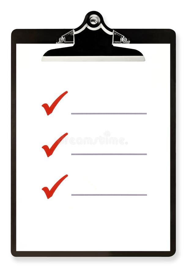 Lista de comprobación en el sujetapapeles imagen de archivo libre de regalías