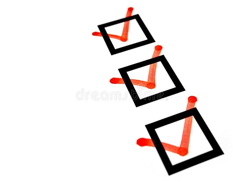 Lista de verificação das caixas de seleção das marcas vermelhas imagens de stock royalty free