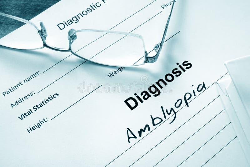 Lista do diagnóstico com ambliopia e vidros fotografia de stock royalty free