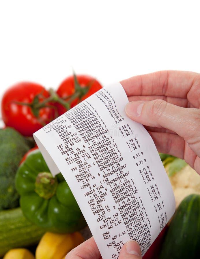 Lista do mantimento sobre um saco vegetais imagens de stock royalty free