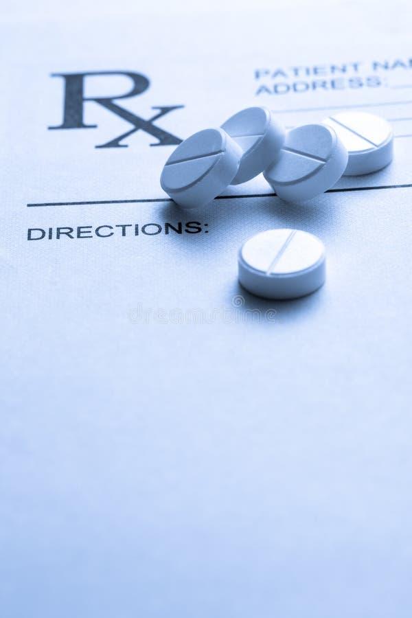 Lista e pillole pazienti immagine stock libera da diritti