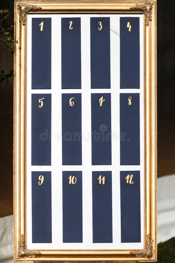 Lista elegante elegante hermosa de la tabla de la huésped de la boda imagen de archivo