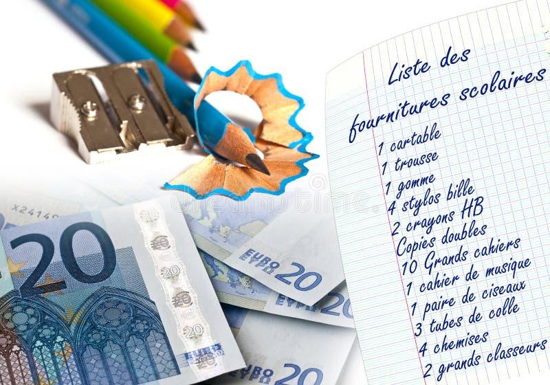 Lista för skolatillförsel som är skriftlig i franskt och euro arkivfoto