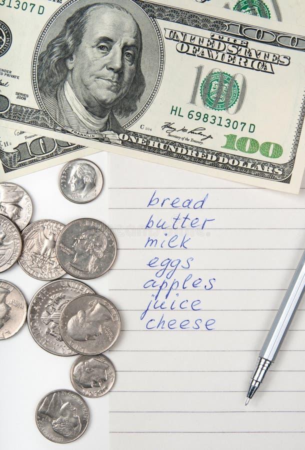 Lista, soldi e penna di acquisto fotografia stock libera da diritti