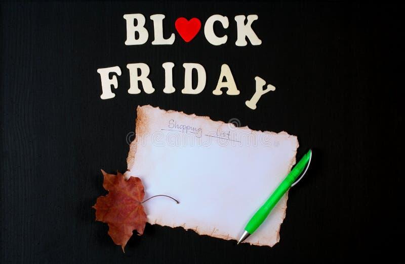 Liste d'achats de Black Friday photos stock