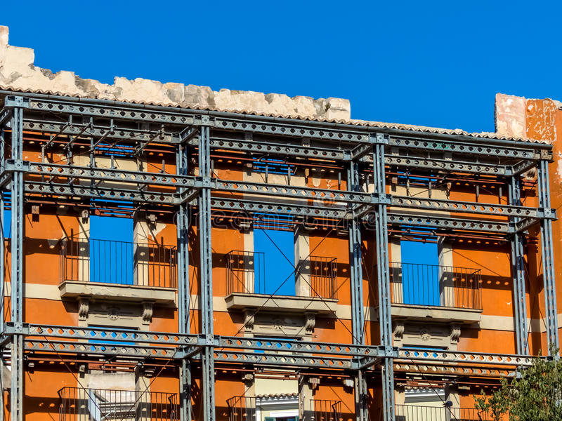 Listed building. The facade of a house that is being rebuilt is a listed building and has to stop stock photo