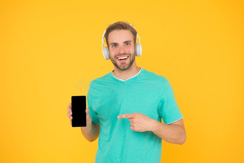 Listen for free. Enjoy music concept. Best music apps that deserve listen. Guy modern user mobile application. Get music royalty free stock photo