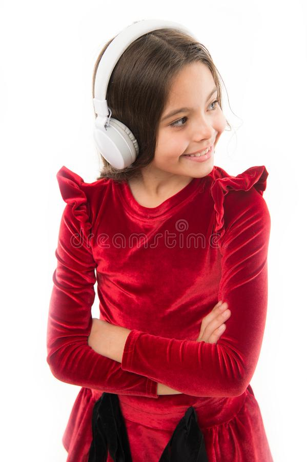 Listen for free new and upcoming popular songs right now. Music always with me. Little girl listen music wireless. Headphones. Online music channel. Girl little royalty free stock photo