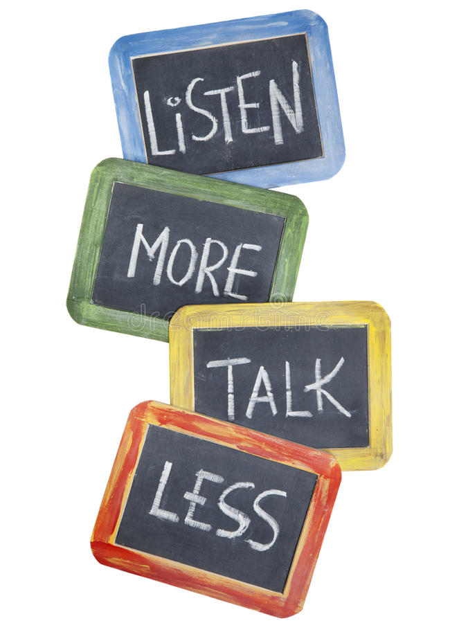 Listen more, talk less. Communication concept or advice - white chalk handwriting on small slate blackboards, isolated on white