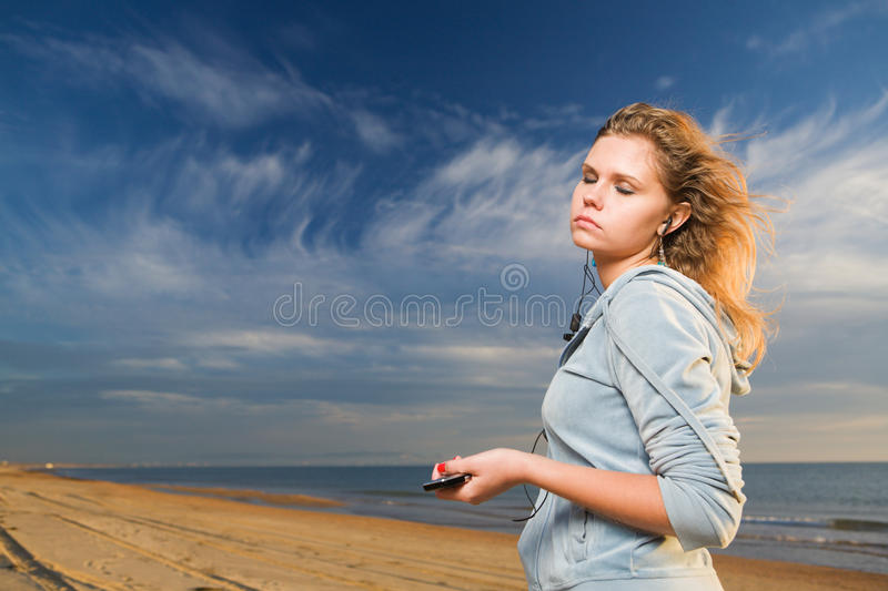 Download Listen music stock photo. Image of face, outdoors, standing - 12465036