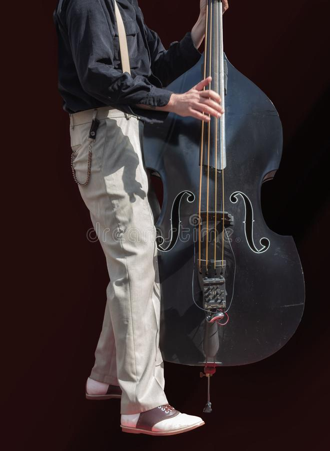 Listen to the bass player royalty free stock photo