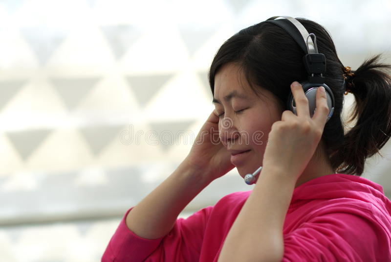 Download Listen to the music stock photo. Image of headphone, woman - 12669516