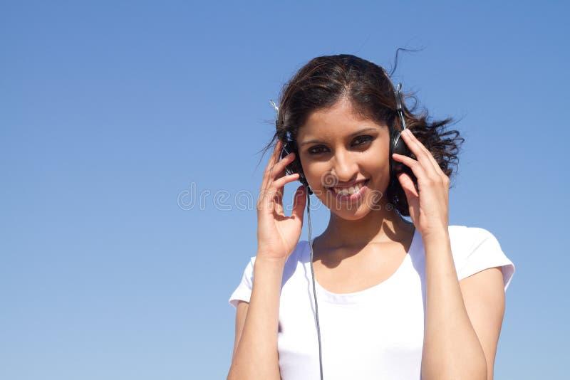 Download Listen to music stock photo. Image of attractive, headphones - 14331456