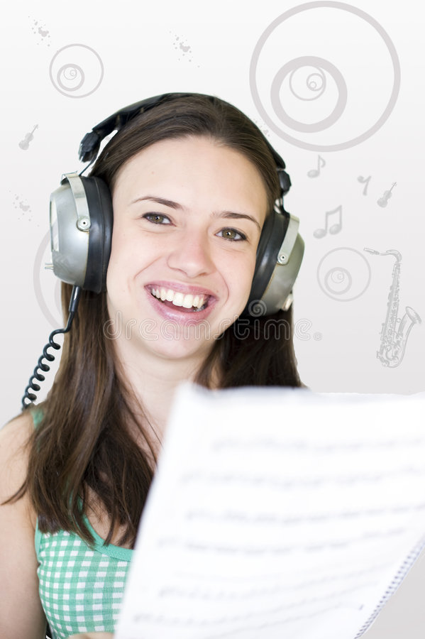 Listen to the music. Woman listening to the music royalty free stock photos