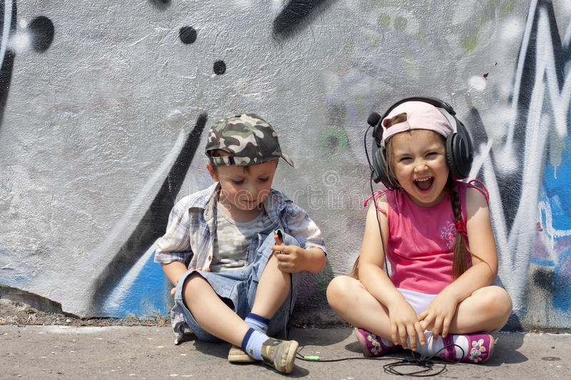 Listen to music abstract with kids stock photos