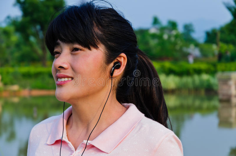 Download Listen To Music Of Asian Women Stock Photo - Image: 28600060