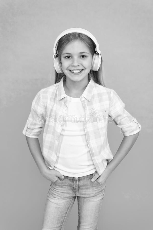 Listen to music. Beauty and fashion. Childhood happiness. Mp3 player. childrens day. Audio technology. small kid listen. Ebook, education. small girl child in royalty free stock image