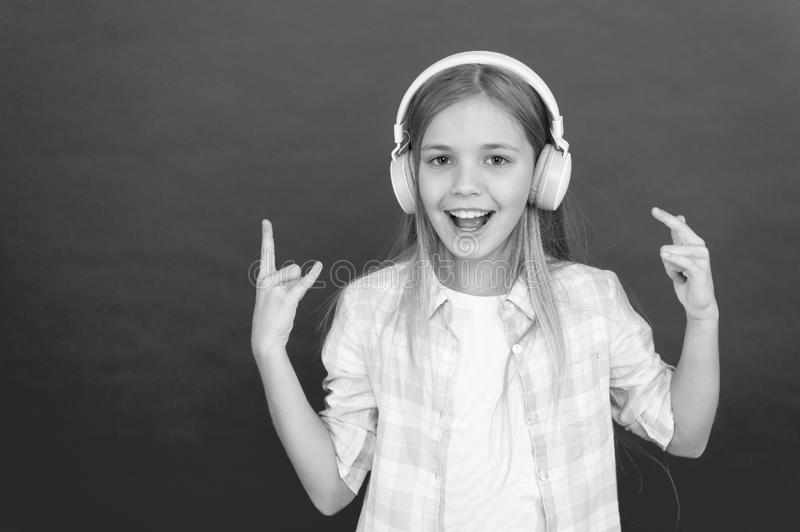 Listen to music. Beauty and fashion. small kid listen ebook, education. Childhood happiness. Mp3 player. childrens day. Audio technology. small girl child in stock image