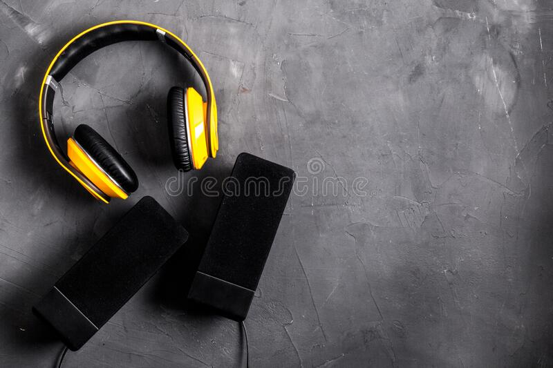 Listen to music concept. audio speakers and headphones on desk copy space royalty free stock images