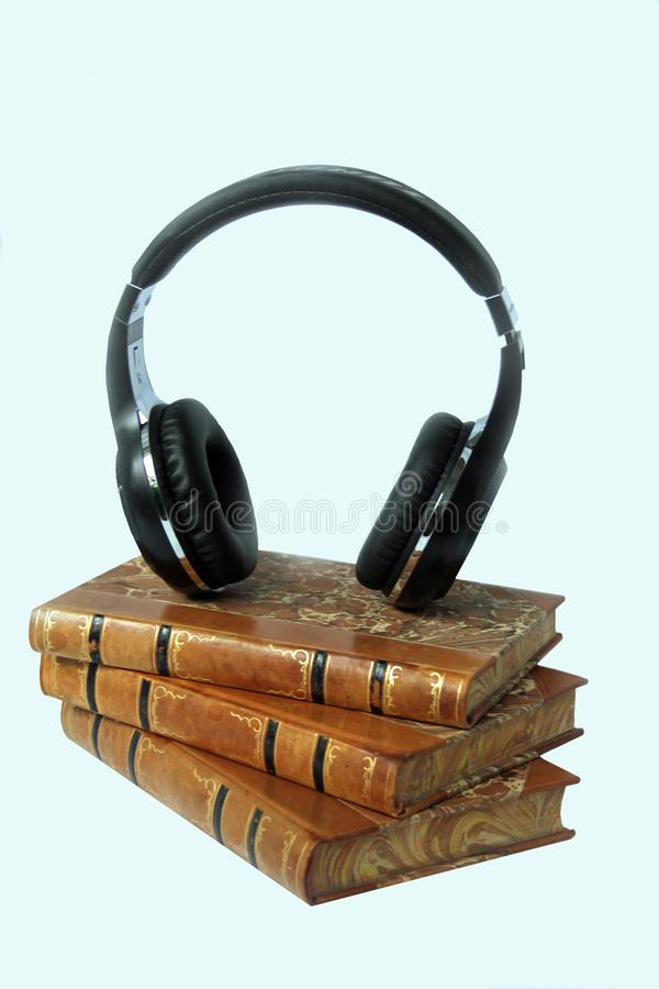 Listen to a story. Relax and listen to a story, Listen to an exciting thriller or a romantic drama in your headphones royalty free stock images