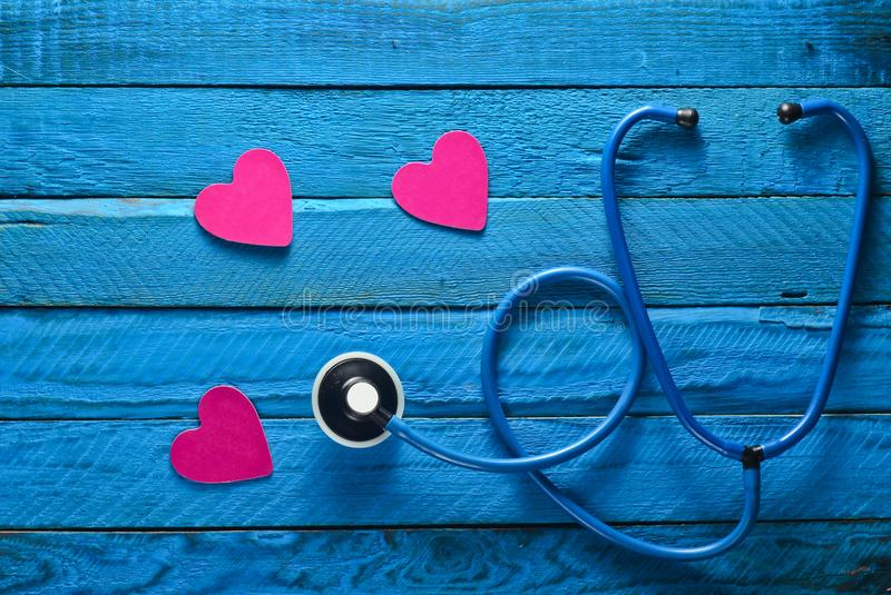 Listen to your heart. Checking the heart for diseases. The concept of care for the heart. Stethoscope. stock photography